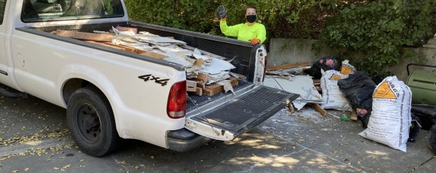 junk in bed of truck by all american hauling