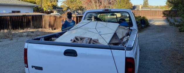 wood strapped down in bed of truck by all american hauling